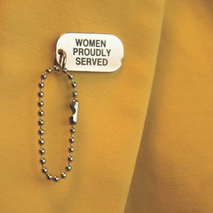 """Close up of """"Women Proudly Serve"""" pin worn by RAND project associate Kayla Williams"""