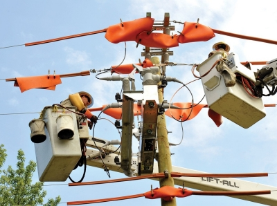 Utility company workers fixing power lines