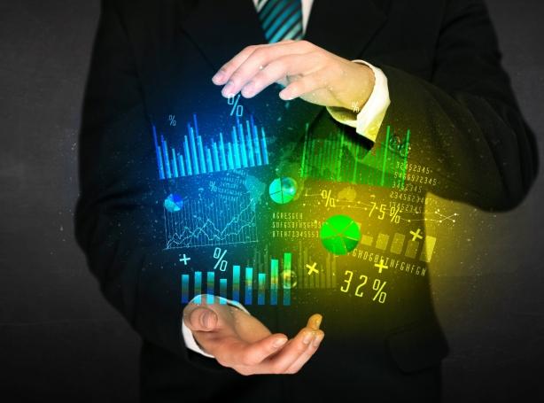 Businessman with diagram cloud