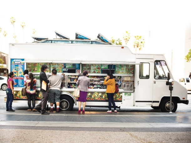 Customers in line at a food truck