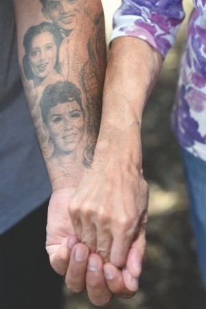 Reyes has a tattoo of his mother, reproduced from her high school ID photo, as a way of honoring her.