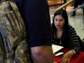David Milan, a retired Lt. Colonel in the Army Reserves, waits to speak with a recruiter during a job fair in Naperville, Illinois, October 27, 2011