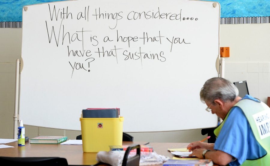 Student in a classroom in Chino State Prison