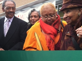 Neighborhood dignitaries gathered in 2013 for a ribbon-cutting ceremony to celebrate the grand opening of the Shop 'n Save supermarket