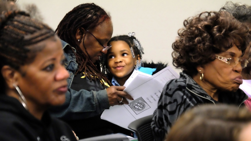 A woman and child at the November 2015 Hill District community meeting, Pittsburgh, PA