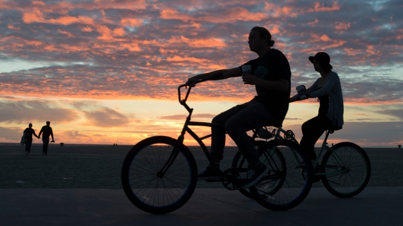 Riding bicycles at the beach in Santa Monica, California
