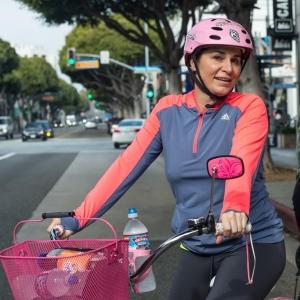 Roula Alaama biking in Santa Monica, California