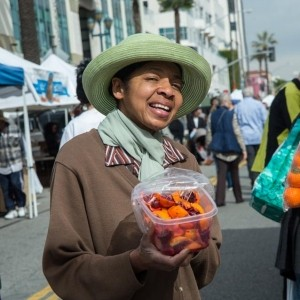 Sister Alberta helps at a produce stand the Santa Monica farmers market