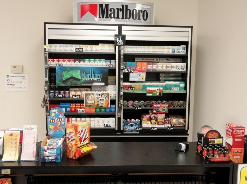 Cigarettes on display behind the cashier at the RAND StoreLab