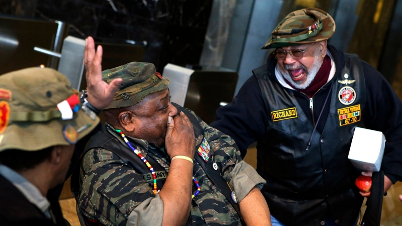 Veteran soldiers laugh during an event honoring Vietnam veterans in New York City, March 29, 2014