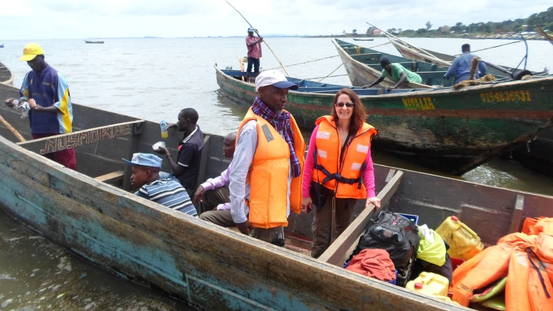RAND senior behavioral scientist Laura Bogart (right) takes a trip to the islands of Lake Victoria to deliver health care services to desperately poor fishermen and their families