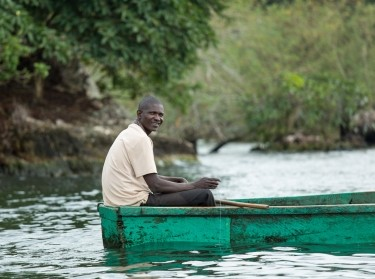 A man rides a boat near the Ssese Islands in Uganda