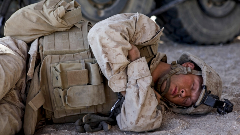 U.S. Marine Corps Lance Cpl. Seth Bower sleeps between fire missions during a training exercise in California, April 27, 2013