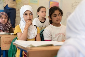 A few of the 28,000 school-age children living at the Zaatari refugee camp in Jordan listening to their teacher