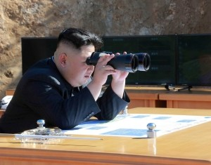 North Korean Leader Kim Jong Un looks on during the test-fire of inter-continental ballistic missile Hwasong-14