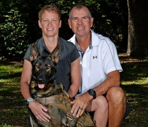 Natalie Vines with her husband, Brian, and her medical service dog, Bugg