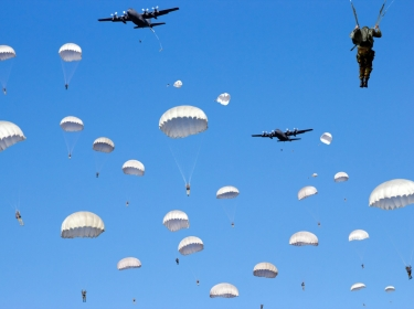 Paratroopers jumping out of a plane