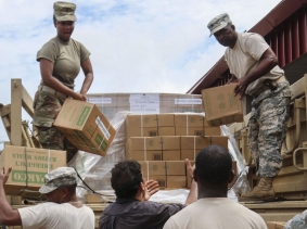 Members of the Virgin Islands National Guard hand out food and water to civilians at a distribution point on St. Croix after Hurricane Irma, September 22, 2017