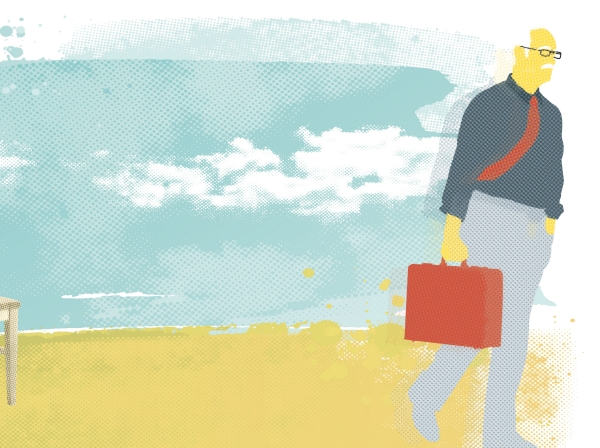 Unretired man on a beach carrying a briefcase