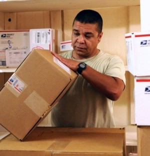 Sgt. John P. Patton, a battalion mail clerk stationed in Iraq, sorts anywhere from 500 to 4,000 packages and letters per week