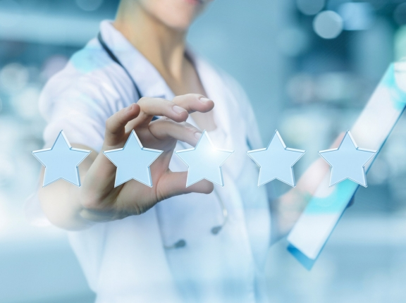 A physician behind star ratings, photo by Natali_Mis/Getty Images