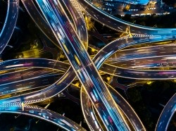 Aerial view of a highway junction at night, photo by DKart/Getty Images