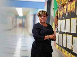 Jessica Coley, a principal-in-training in Prince George's County, Md., stands by some student project work in her school, photo by Karen Sayre
