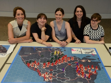 Lauren Buitta, founder of Girl Security, and RAND's Jenny Oberholtzer, Stacie Pettyjohn, Becca Wasser, and Ellie Bartels host a wargame for girls, July 2019, photo by Dori Gordon Walker/RAND Corporation