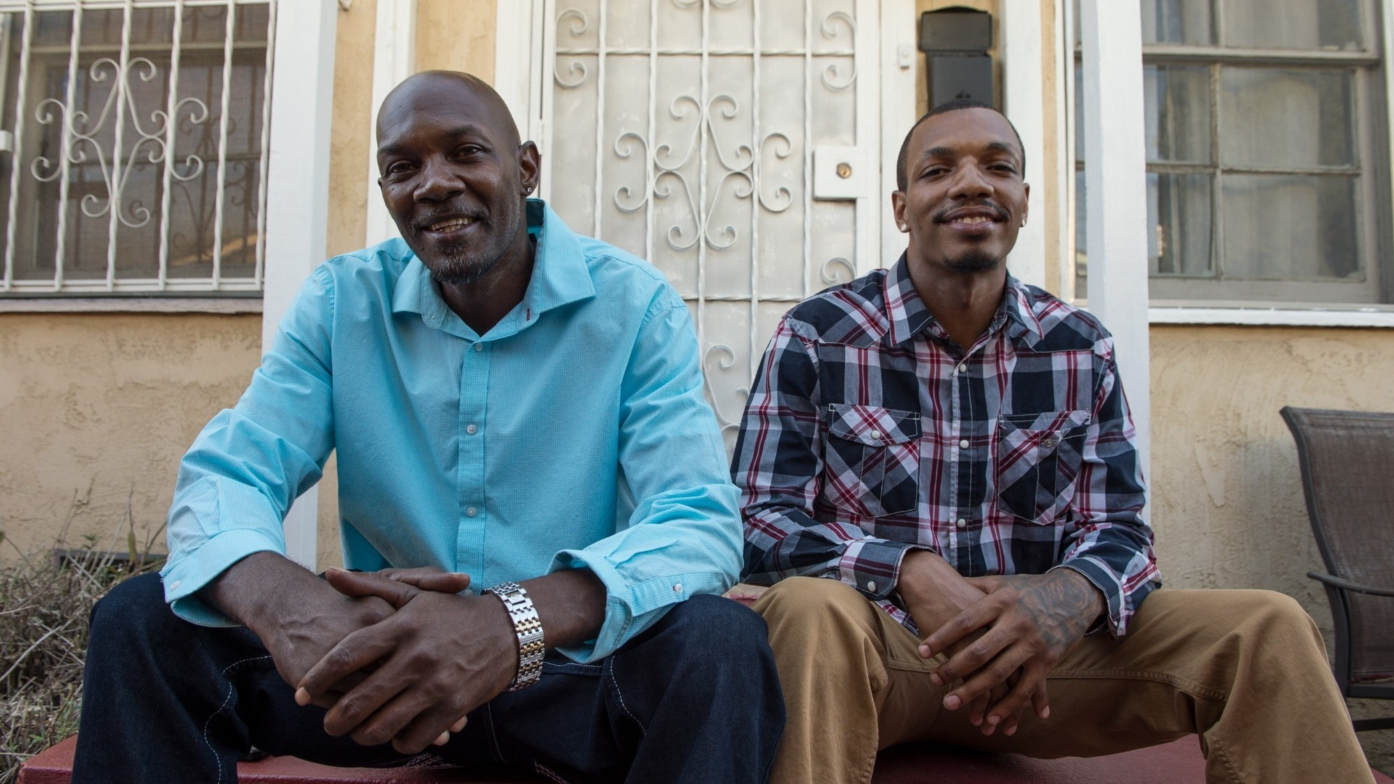 Eric Holmes and son Justin at home in South Central, Los Angeles, photo by Diane Baldwin/RAND Corporation