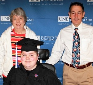 Alice and Brian Denger pose with their son Patrick at his 2017 commencement, photo courtesy of the Denger family