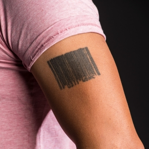 Jonathan Wong's tattoo of a bar code with USMC, photo by Diane Baldwin/RAND Corporation