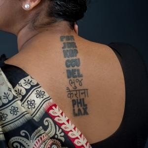 Hardika Dayalani's tattoo of airport codes, photo by Diane Baldwin/RAND Corporation