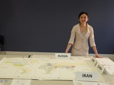 Yuna Wong standing behind a wargame, photo by Dori Walker/RAND Corporation