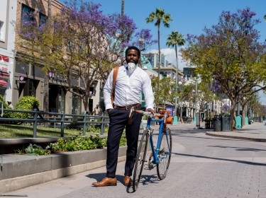 Jonathan Welburn stands on Santa Monica's nearly deserted Third Street Promenade in May 2020, photo by Diane Baldwin/RAND Corporation