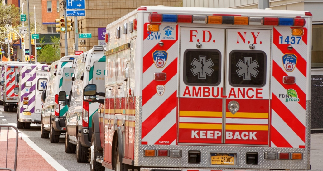 Ambulances line up outside a New York City hospital emergency room waiting for the next spike in calls, May 4, 2020