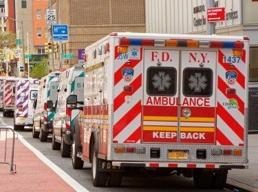 Ambulances line up outside a New York City hospital emergency room waiting for the next spike in calls, May 4, 2020, photo by Bob London/Alamy