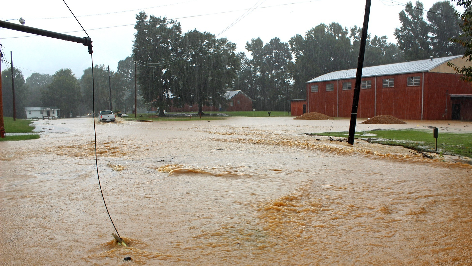 A flooded road in Duck Hill, Miss., in July 2018, photo by Romona Williams