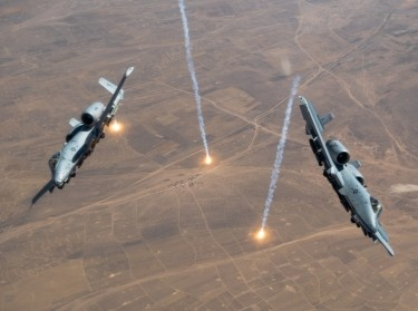 Two USAF A-10 Thunderbolt IIs release countermeasure flares over the U.S. Central Command area of responsibility, July 23, 2020, photo by Staff Sgt. Justin Parsons/U.S. Air Force