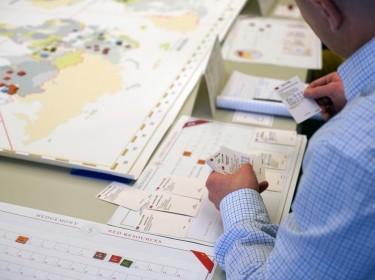 A person playing Hedgemony, a tabletop military strategy game developed by RAND, photo by Evan Banks/RAND Corporation