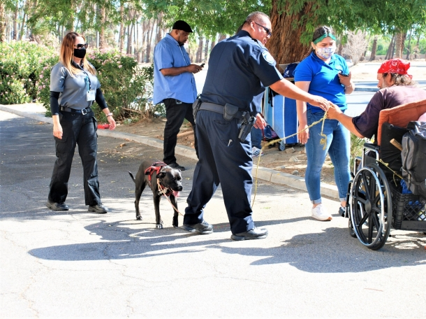 Officer Jose Ibarra and clinical therapist Cynthia Ferreiro (far left) assist a man in Indio, California, photo courtesy of Indio Police Department