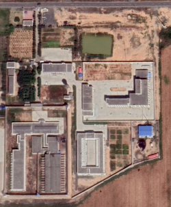 A satellite image shows what appears to be a multifacility detention center in Xinjiang, China, image by Digital Globe and NGA Tearline
