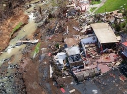 Aerial view of a damaged home in the mountainous area of Barranquitas, Puerto Rico, October 9, 2017, photo by Andrea Booher/FEMA