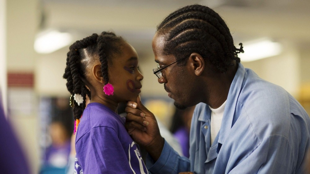 A man visits with his daughter on Father's Day at a prison in San Luis Obispo, California, photo by Mario Anzuoni/Reuters