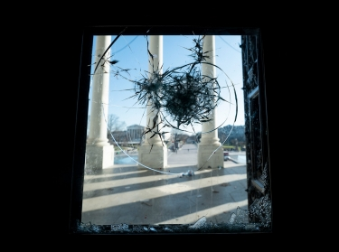 The east front of the U.S. Capitol seen through a shattered door on January 7, 2021, the day after the riot, photo by Bill Clark/CQ Roll Call via AP Images