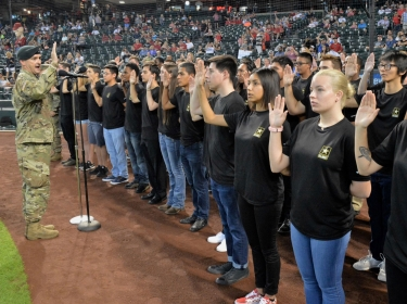 Lt. Col. Scott Morley, commander of the Phoenix Recruiting Battalion, administers the oath of enlistment to 40 future soldiers, August 26, 2018, at Chase Field, photo by Mike Scheck/U.S. Army