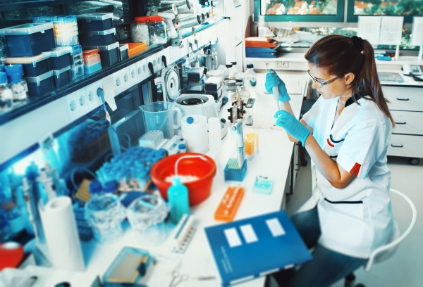 Scientist conducts research in a lab