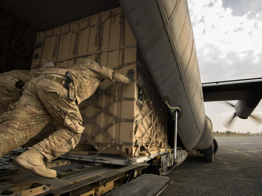 Aerial porters move a shipping container into a 774th Expeditionary Airlift Squadron C-130 Hercules cargo plane at Forward Operating Base Salerno, Khost province, Afghanistan, September 22, 2013