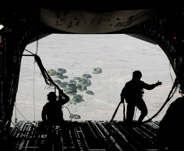 Air Force loadmasters conduct an airdrop from a C-17 Globemaster III aircraft over the southern region of Afghanistan, September 2, 2009