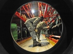 Airmen perform warehouse location checks at Whiteman Air Force Base, Mo., June 25, 2013
