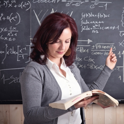 calculus teacher at the chalkboard